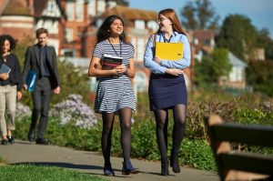 students walking in school grounds on a sunny day