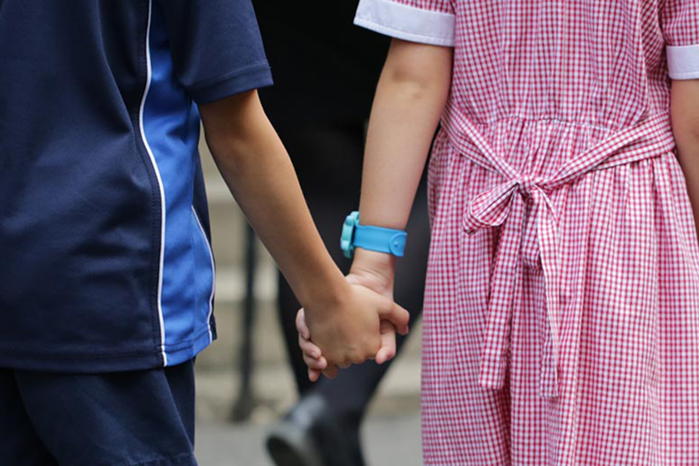 Students holding hands