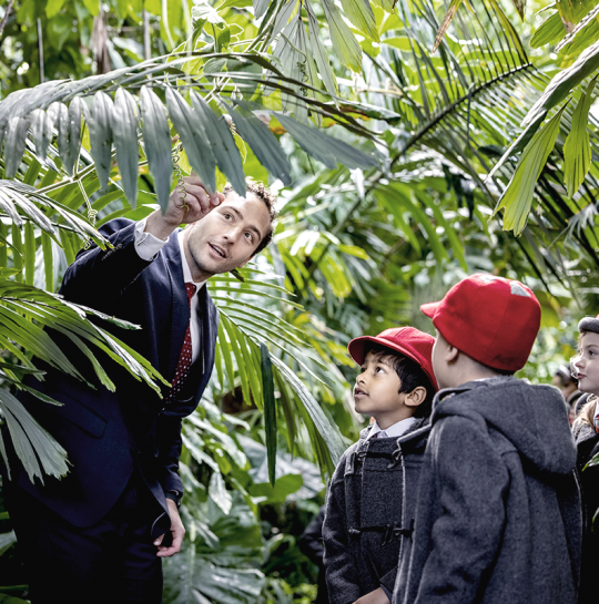 Broomfield House Teacher in Kew Greenhoues with pupils
